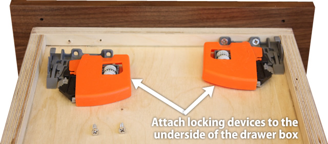 attach locking devices to the drawer box